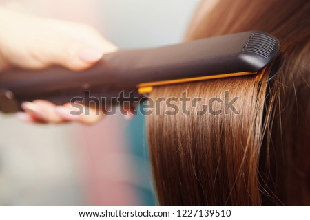 Hair iron straightening beauty care salon spa. #1227139510