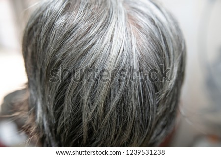 hair is turning grey in an old people. (hair turns grey - close up shot)