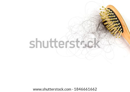 Hair loss stick to comb,Hair loss, hair loss every day, serious problems and hair loss on a white background.