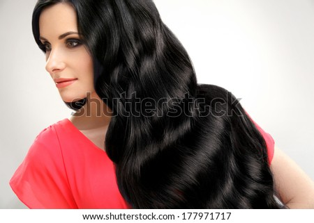 Hair. Portrait of Beautiful Woman with Black Wavy Hair. High quality image.