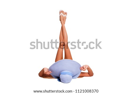 Hair Removal, Beautiful Legs. Beautiful Female Feet, smooth Silky Skin without Hair. healthy smooth skin on female legs. model lying on his back with his legs raised in the top, hat on his head view