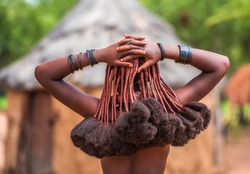 Hair style of Himba women, tribespeople living in northern Namibia