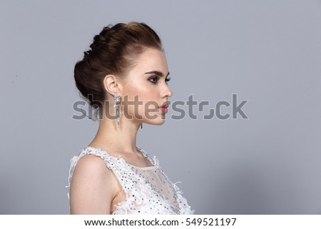 Hair Styling Rear View, Black color caucasian Bride hair style, White Wedding Lace Dress beauty shoot, studio lighting gray background