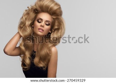 Hair volume. Portrait of beautiful Blonde with Long Wavy Hair. High quality image.