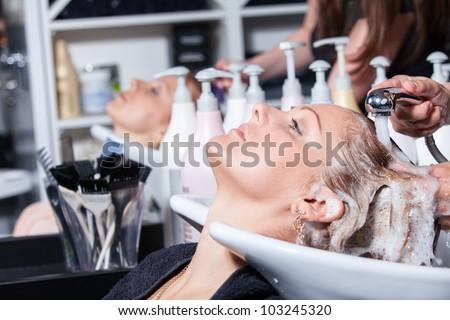 hair washing at a hairdressing salon, young caucasian girl - stock photo