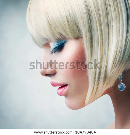 Haircut. Beautiful Girl with Healthy Short Blond Hair. Hairstyle
