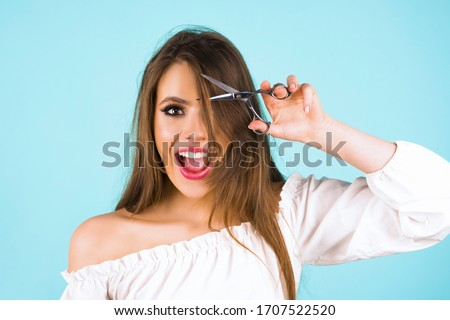 Haircut. Beautiful woman cut her hair. Women's haircut and hairdresser. Bangs hair. Close up hairstyle with bangs Stockfoto ©
