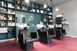 Hairdresser armchairs Banner. Modern beauty room and hair salon for women, big choice of professional cosmetics.