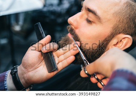 Shutterstock Hairdresser cuts client in Barbershop