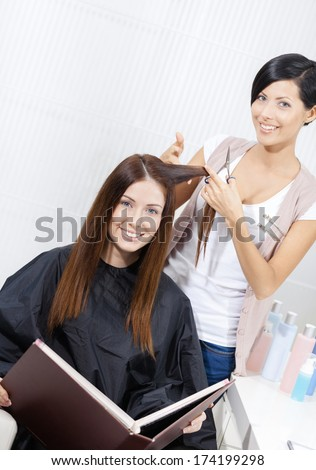 Hairdresser cuts hair of woman in hairdresser\'s. Concept of fashion and care