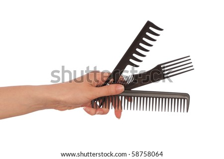 hairdresser holds the black tools for haircut