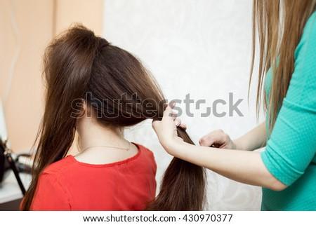 Hairdresser make evening hairstyle  #430970377