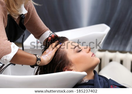 Hairdresser salon Woman during hair wash