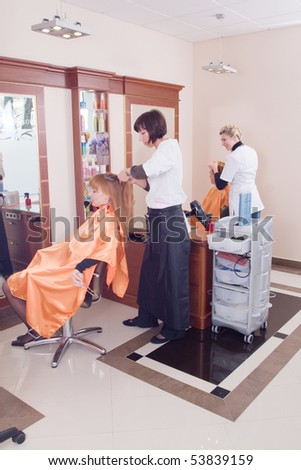 Hairdresser-womens  makes hair young women