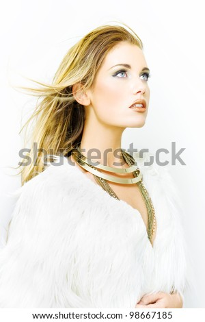 Hairdressing And Hairstyling Studio Photo Of A Beautiful Woman With Flowing Golden Blond Locks Of Hair Blowing In The Wind While Standing In A Beauty Salon