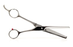 hairdressing scissors on an isolated white background