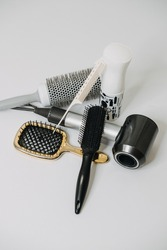 Hairdressing Tools and Equipment. Hair dryer, Paddle Brush, variety of combs, Water Bottle, Round Brush, texture iron or mini crimping iron