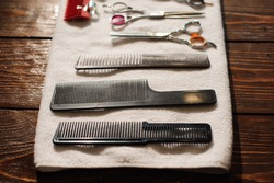 hairdressing tools on a towel - scissors, combs, clipper