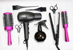 Hairdressing tools on silver background