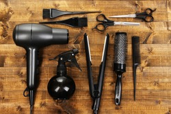 Hairdressing tools on wooden table close-up