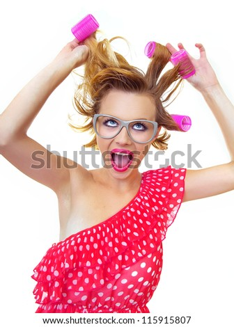Hairstyle Pin-Up Girl holding curlers, isolated on white