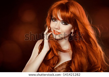 Hairstyle. Red Hair. Attractive smiling girl with long Curly Hair. Happy smiling woman.
