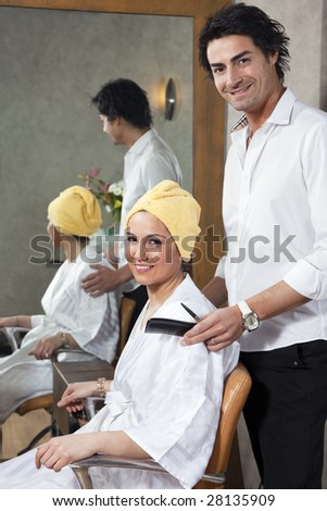 hairstylist and customer looking at camera and smiling