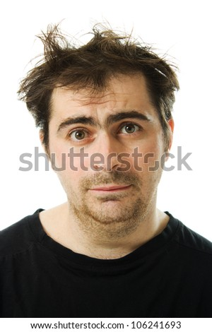 Hairy tired man on white background.