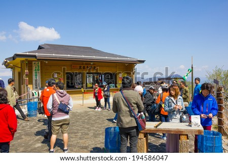 HAKONE -APR 23:Tourists buy the signature Black-boiled egg from the shop at Owakudani hot spring area in Hakone, Japan on 23th April 2014.Owakudani is the tourist attactive area in Fuji volcanic zone.