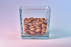 Half a glass with small coins.