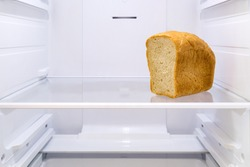 half a loaf of bread on the shelf in the empty refrigerator