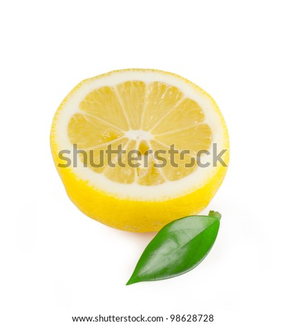 Half a ripe lemon with leaf isolated on white background