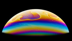 Half a soap bubble. Close-up. Black background. Bright colors. Side view. A high resolution. Imitation of an unknown planet. Children's entertainment. Science fiction.