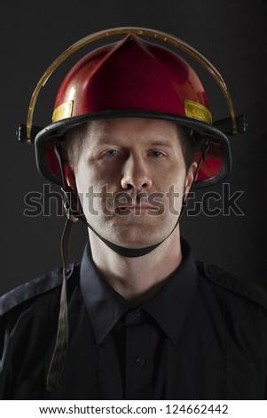 Half body portrait of a fireman a wearing helmet