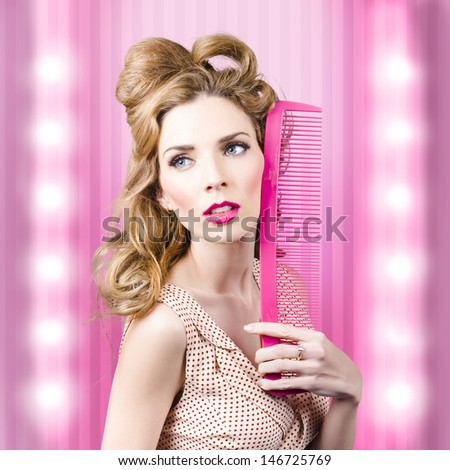 Half body portrait of a serious sexy girl with brown hair dressed in retro fashion standing inside a barber salon with beauty comb. Fashion faux pas