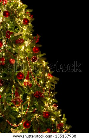 Half christmas tree cut out on black with copy space