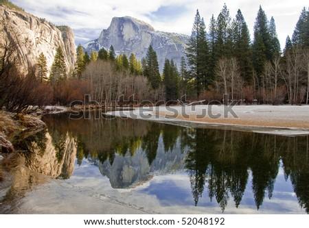 Half Dome reflected in lake in Yosemite National Park