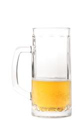 Half-drank beer mug with a big handle isolated on white