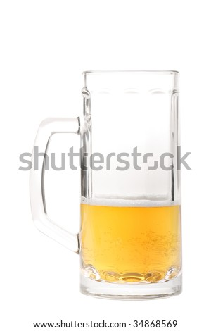 Half-drank beer mug with a big handle isolated on white