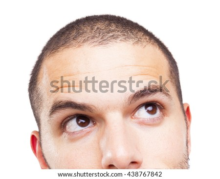 Half face of a young man looking up, isolated on white background #438767842