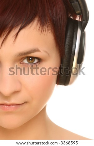 half face of young girl in headphones