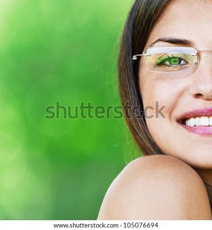 half face young beautiful girl dark closeups short hair glasses summer park smiling