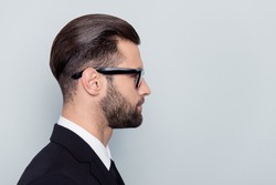 Half-faced profile side view close up portrait of serious focused handsome attractive style stylish modern masculine guy with trendy hairstyle isolated on gray background copy-sapce