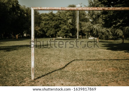 Half Football goal, urban park with tree nobody play