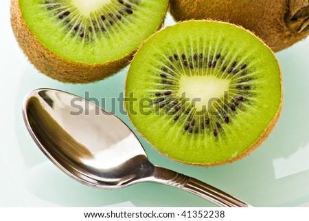 half fresh kiwi and spoon
