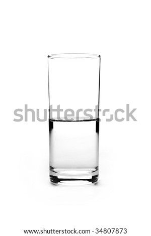 Half full glass of water is isolated on a white background