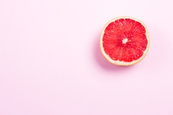 Half grapefruit citrus fruit on pink background