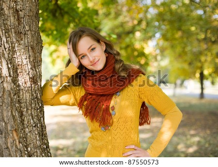 Half length portrait colorful fall fashion girl in the park.