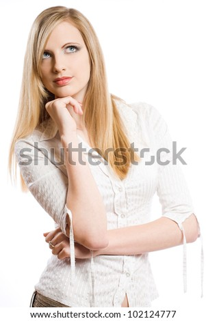 Half length portrait of a beautiful young blond woman pondering.