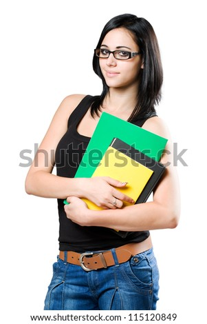 Half length portrait of a cute young student girl holding colorful exercise books.